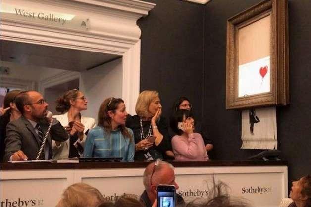 Перед самознищенням картину продали за понад мільйон доларів — Бенксі показав підготовку до самознищення своєї картини на аукціоні Sotheby's